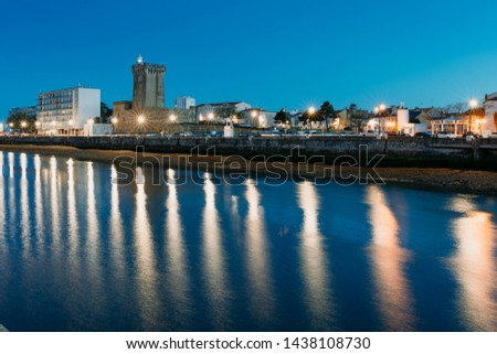 Port and marina of Les Sable D'olonne, France at dusk with reflections in the water