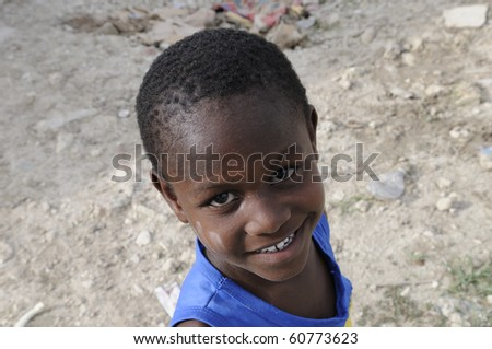 "PORT-AU-PRINCE - AUGUST 28:  A small unidentified kid during his leisure time  in the Tent city called "" ACRA""on August 28, 2010 in Port-Au-Prince, Haiti"