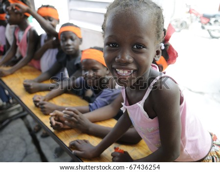 PORT-AU-PRINCE - AUGUST 25: An unidentified school student sharing a laugh while in class in a small school in Cite Soleil,  in Port-Au-Prince, Haiti on August 25, 2010.