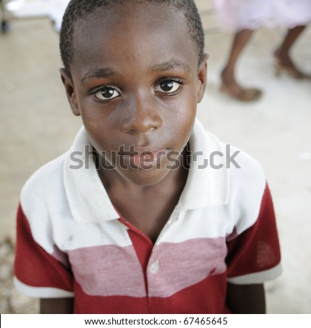 PORT-AU-PRINCE - AUGUST 22:  Innocent look of an unidentified Haitian child during a food distribution camp in Port-Au-Prince, Haiti on August 22, 2010.