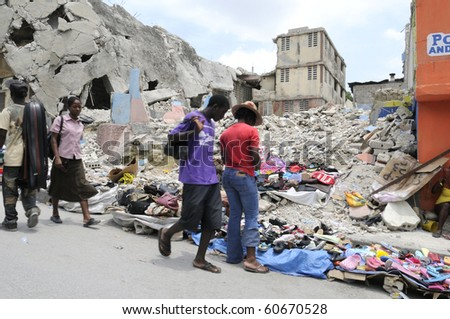 PORT-AU-PRINCE - AUGUST 21: People buying and selling stuffs in front of a collapsed building in   Port-Au-Prince, Haiti on August 21  2010.
