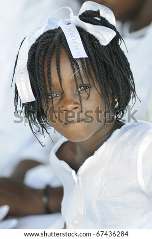 PORT-AU-PRINCE - SEPTEMBER 1:  An unidentified small Haitian girl looking with grief during her 6 month old brother's funeral who was burnt alive,  in Port-Au-Prince, Haiti on September 1, 2010.