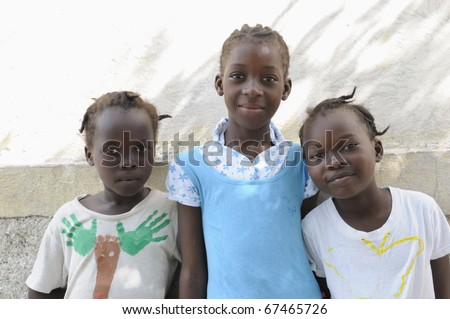 PORT-AU-PRINCE - SEPTEMBER 2:  Happy looking innocent unidentified Haitian kids during a camp  in Port-Au-Prince, Haiti on September 2, 2010. - stock photo