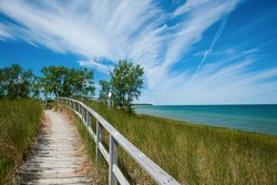 Port Austin, Michigan, United States - July 7th 2016: A view of the beach and the lake where Saginaw Bay and Lake Huron meet at Port Crescent State Park.