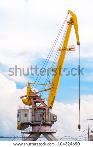 Port crane boom. Photo in the sky