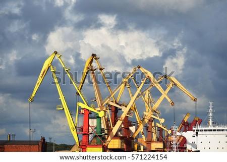 Port cranes loading a bulker ship in Ventspils free port #571224154