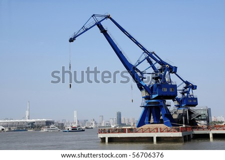 port cranes with blue sky