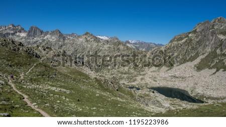 Port de Caldes lake of glacial origin at 2,412 m ASL, as seen from  Port de Caldes de Colomers mountain pass at 2,572 m ASL, Aiguestortes & Estany de Sant Maurici National Park, Pyrenees, Spain #1195223986