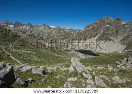 Port de Caldes lake of glacial origin at 2,412 m ASL, as seen from  Port de Caldes de Colomers mountain pass at 2,572 m ASL, Aiguestortes & Estany de Sant Maurici National Park, Pyrenees, Spain #1195223989