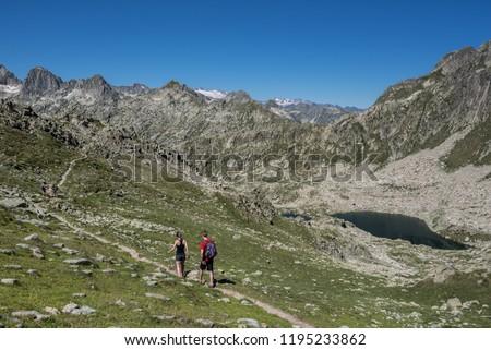 Port de Caldes lake of glacial origin at 2,412 m ASL, as seen from  Port de Caldes de Colomers mountain pass at 2,572 m ASL, Aiguestortes & Estany de Sant Maurici National Park, Pyrenees, Spain #1195233862