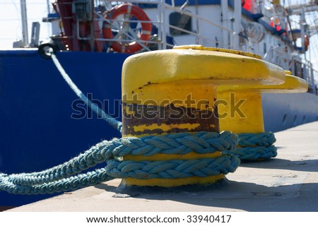 port detail and ship to fasten the mooring rope to the bollard