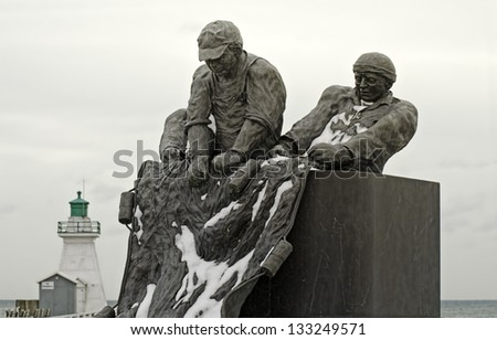 PORT DOVER-MARCH 16: Fishermen Monument on March 16, 2013 in Port Dover, Ontario. The sculpture is dedicated to commercial fishermen who lost their lives on Lake Erie and located near the lighthouse