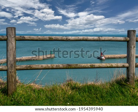 Port-en-Bessin-Huppain, France. A small picturesque fishing port in Normandy. Widok from the mountain panorama, blue sky. Zdjęcia stock ©