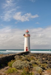 Port Fairy Lighthouse, built in 1859 is a magnificent red and white sentinel that stands on the easternmost tip of Griffiths Island, looking out over Port Fairy Bay and the mouth of the Moyne River