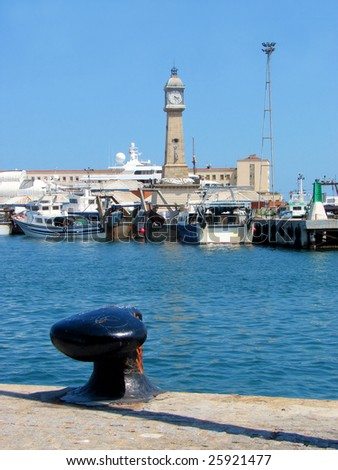 port in barcelona with  fishing ships and a tower with hours. Port Well. spain