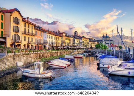 Port in the Old Town of Cannobio, Italy, a famous tourist resort on Lago Maggiore lake, in dramatic sunset light #648204049