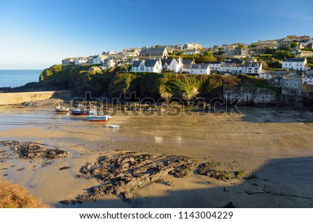 Port Isaac, a small and picturesque fishing village on the Atlantic coast of north Cornwall, England, United Kingdom, famous as backdrop to various television productions, on sunny autumn morning.