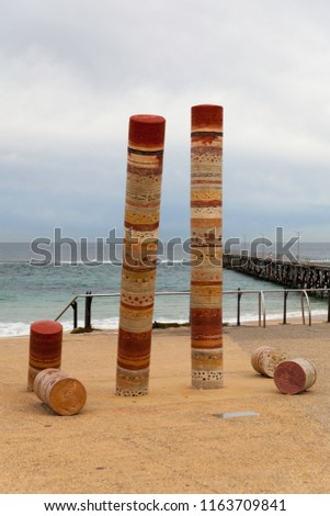 Port Noarlunga Beach with Jetty and Guildhouse art statue, ominent. Beach and Jetty in the Background. #1163709841