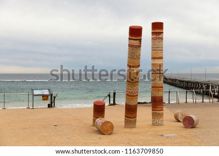 Port Noarlunga Beach with Jetty and Guildhouse art statue, ominent. Beach and Jetty in the Background. #1163709850