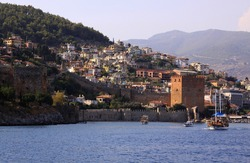 Port of Alanya, Turkey afternoon landscape view with castle and ships sailing on the sea