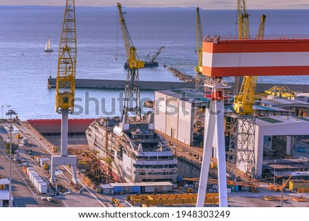 Port of ancona cruise ship under construction,fincantieri  shipyard,luxury cruise ship under construction,crane working to assemble the ship,dry dock,  cruise ship delivery