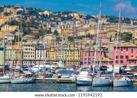 Port of Genoa (Genova), Italy. View from the sea towards the old town on a summer sunny day. Harbor, yachts at the pier. Center of the Ligurian Riviera. Tourist attraction, tourist destination. #1195942192