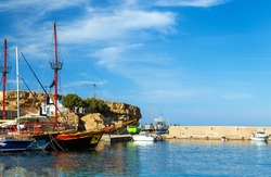 Port of Hersonissos with Boats in Blue Water and Hills on the Background, Crete Island, Greece