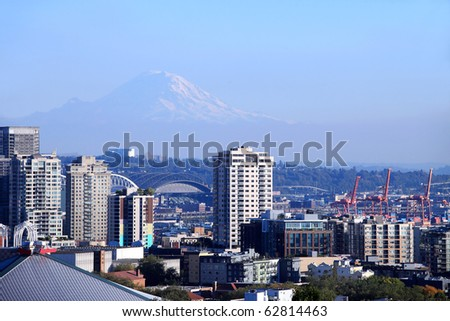 Port of Seattle & residential buildings with Mt. Rainier in the background.
