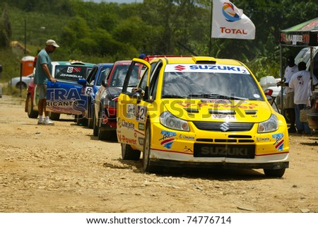 PORT OF SPAIN - APRIL 3: Action during the Trinidad and Tobago 2011 Motor Car Rally meet April 3, 2011 in Cipero, Trinidad & Tobago.  It is the largest motor sport event in the country. - stock photo