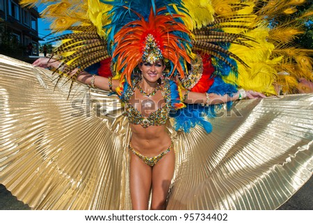 PORT OF SPAIN, TRINIDAD – FEB 21: A Female Masquerader enjoys herself in the Harts Carnival presentation 'Pantheon-wrath of the gods', February 21, 2012 in Port of Spain, Trinidad.