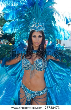 PORT OF SPAIN, TRINIDAD – February21: A Female Masquerader enjoys herself in the Harts Carnival presentation 'Pantheon-wrath of the gods', February 21, 2012 in Port of Spain, Trinidad.