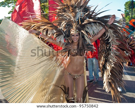 PORT OF SPAIN, TRINIDAD – FEBRUARY 21: An unidentified female masquerader enjoys herself in the Harts Carnival presentation 'Pantheon-wrath of the gods', February 21, 2012 in Port of Spain, Trinidad.
