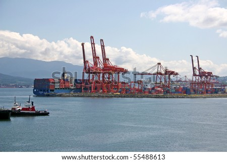 Port of Vancouver harbor container terminal and crane.