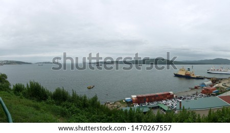 Port of Vladivostok panoramic harbor  view with and harbor bridge with moored ships with icebreaker #1470267557