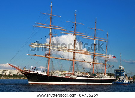 "PORT WARNEMÜNDE, GERMANY - AUGUST 13: Evening cruise of the old Russian Sailing ship ""SEDOV"" on August 13, 2011 during the 21st annual Hanse-Sail event in Port Warnemunde, Germany."