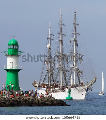 "PORT WARNEMUENDE, GERMANY - AUGUST 10. Old norwegian Sailing ship ""Christian Radich"" arrives at the port Rostock on August 10, 2013 for the 23. Hanse-Sail, Mecklenburg-Vorpommern, Germany"