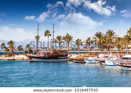 Port with sightseeing boats, beautiful scenery, Resort town Side in Turkey