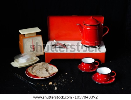 Portable camping cooker in a red and black interior with antiquities #1059843392