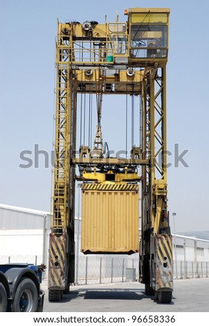 Portable crane for moving big containers - stock photo