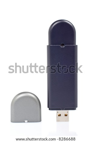 Portable flash usb pen drive memory reflected on white background. Shallow DOF