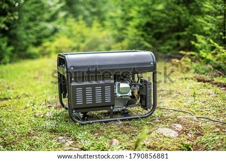 Portable gasoline generator in the open air, in nature. Foto d'archivio ©