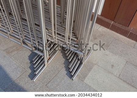 Portable sectional fence close-up. Mobile metal fences made of stainless steel. Temporary fences made of pipes. ストックフォト ©