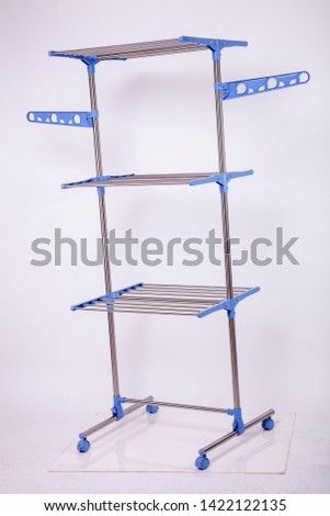portable 3 shelves clothes hanger home office utensil Silver stainless metal dress shirts on white dresses awesome Awesome different alternative compositions made of macro shots