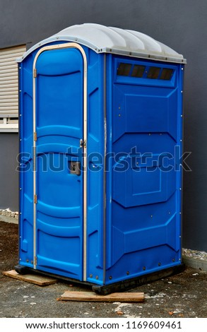 Portable toilet on the street in the city #1169609461