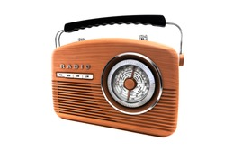 Portable wooden retro radio in front of white background. Vintage object isolated. Listen music concept. Old portable music player.