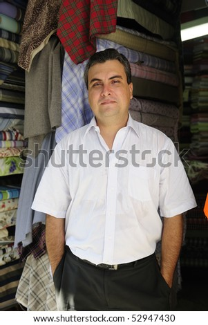 portait of  a proud and confident retail store owner