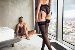 Portait of a sensual, young couple relaxing in a luxurious apartment