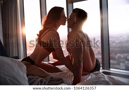 Portait of a sensual, young couple relaxing in a luxurious apartment #1064126357