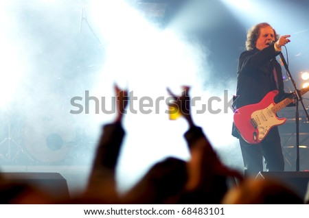 PORTEL VILLAGE, PORTUGAL-NOVEMBER 28: first portuguese rock band in concert on November 28, 2010 in Montado traditional portuguese fair. Antonio Manuel Ribeiro, vocalist and founder of UHF band.