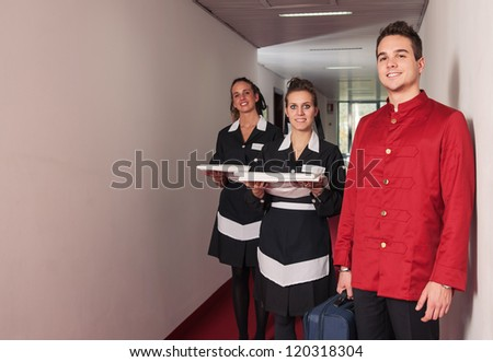 Porter and chambermaid women during service in a hotel.
